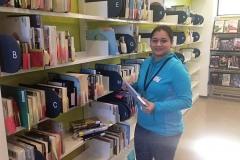 Aarti (volunteer) shelving at CAP Library