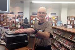 Bill (volunteer) shelving at Rox Library