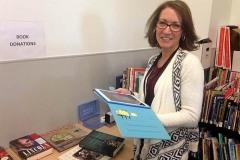 Emily (volunteer) sorting books for book store at CAP Library