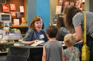 Douglas County Libraries, volunteer working with children