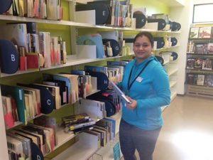 Aarti-volunteer-shelving-at-CAP-Library