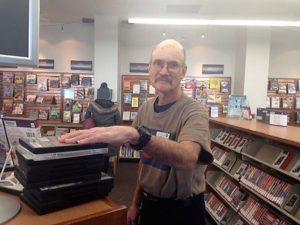 Bill-volunteer-shelving-at-Rox-Library