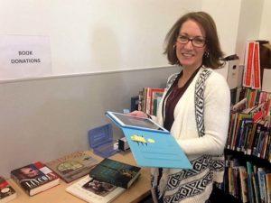 Emily-volunteer-sorting-books-for-book-store-at-CAP-Library