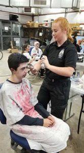 Halloween-Town-of-CR-Tori-doing-hair-on-Brandon-Scott